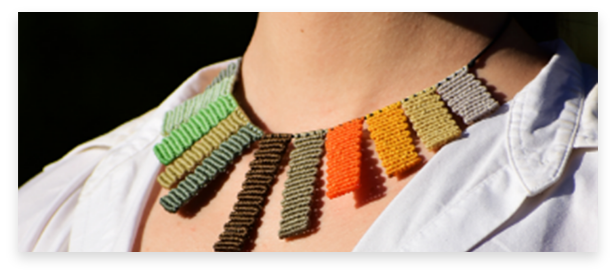 handmade jewelry, necklaces, earrings and crochet bags available. in the picture, colorful macrame necklace